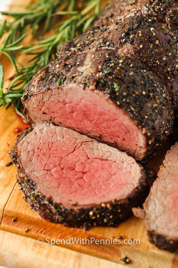 slice of Roast Beef Tenderloin on a cutting board