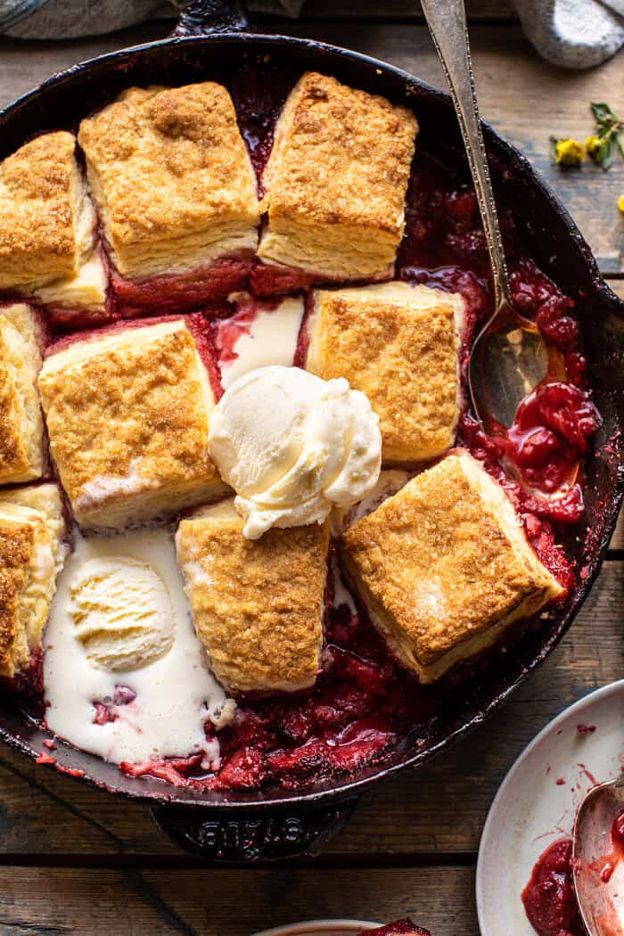 Skillet Strawberry Bourbon Cobbler with Layered Cream Cheese Biscuits   halfbakedharvest.com