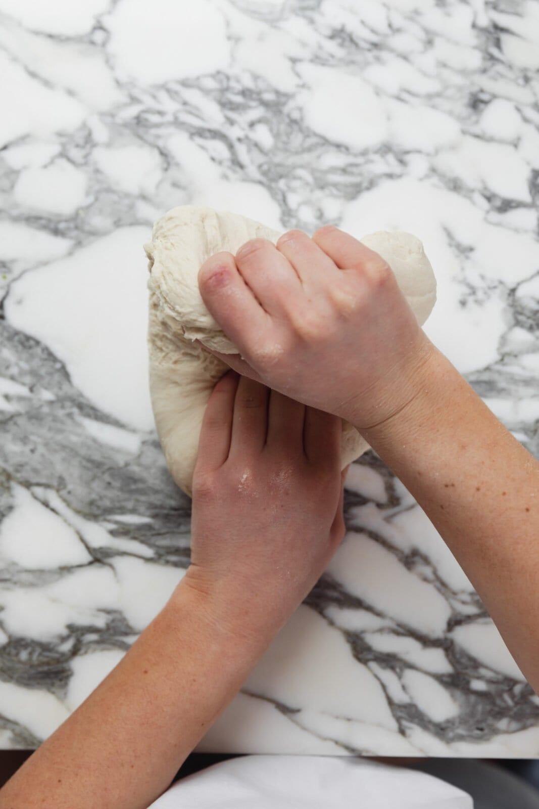 folding bagel dough over itself