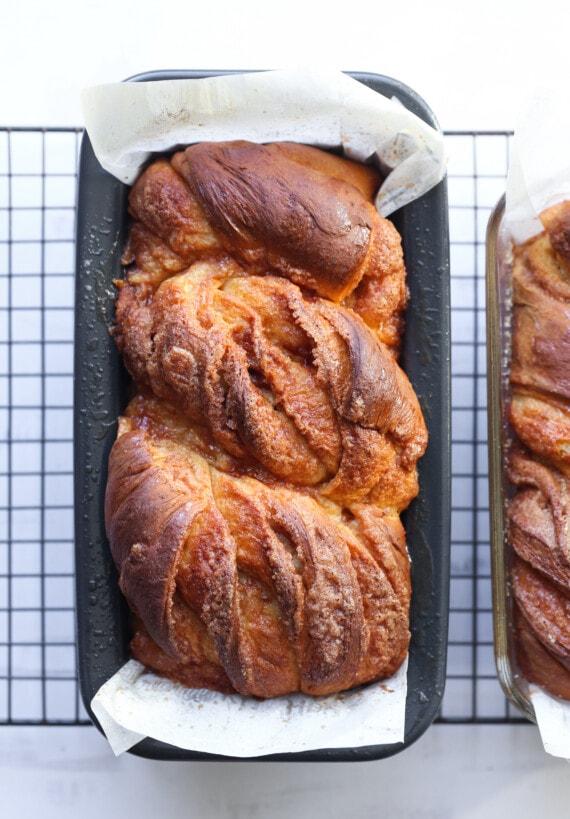 Two baked loaves of cinnamon babka.