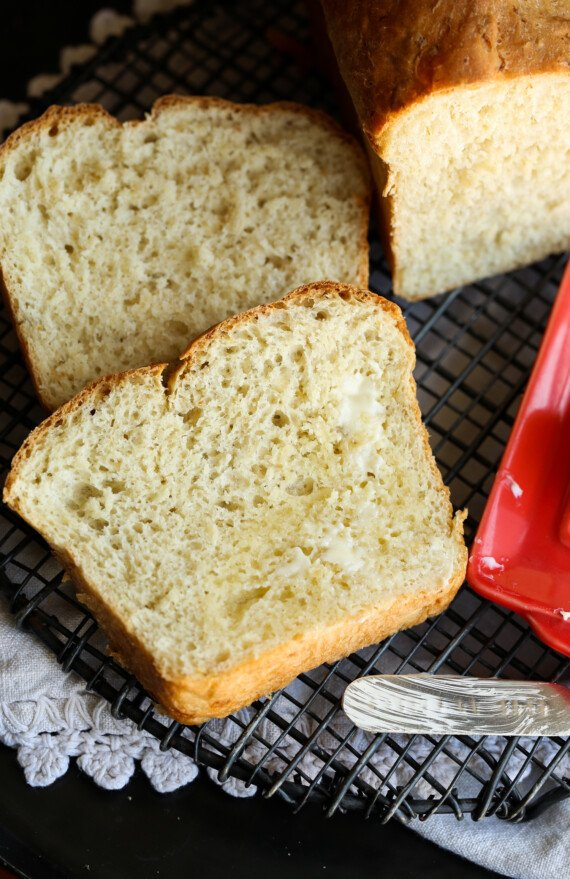 Sliced and buttered honey oatmeal bread.