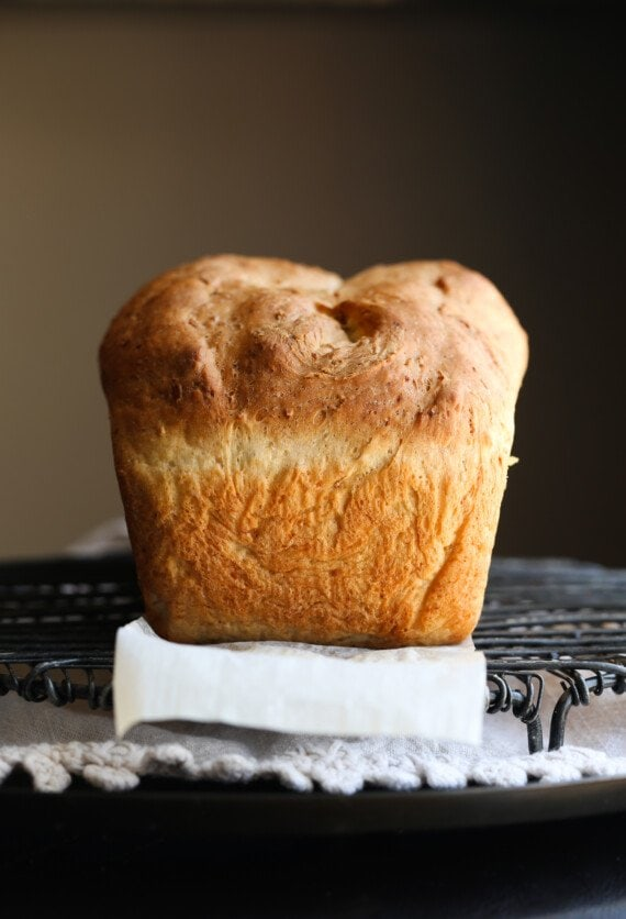Baked loaf of no knead honey oatmeal bread.