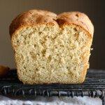 Sliced loaf of honey oatmeal bread.