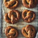 6 salted pretzels on a cooling rack.