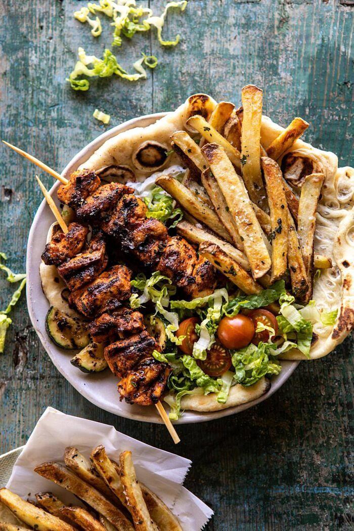 Chicken Souvlaki Bowls with Garlic Fries   halfbakedharvest.com #greek #healthyrecipes #dinner #summerrecipes