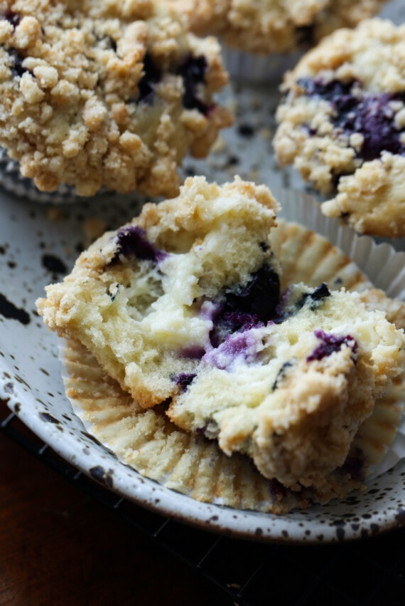 Blueberry Muffin broken in half with cream cheese filling in the center