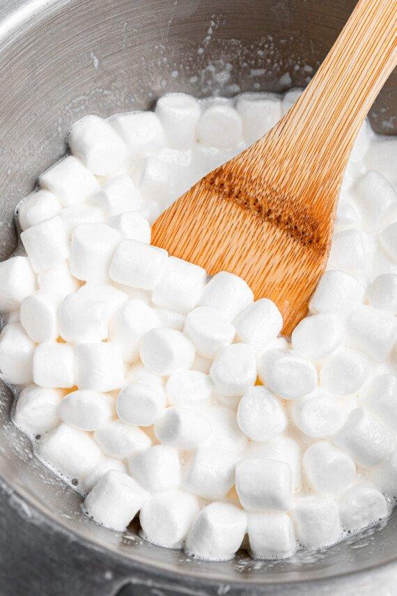 Mini marshmallows and milk in a sauce pan.